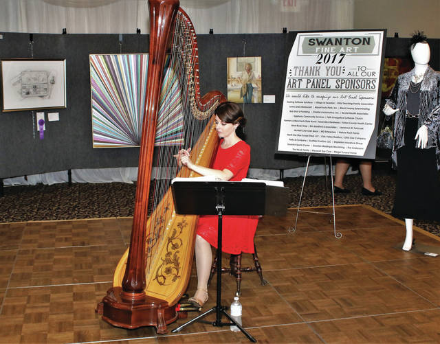 Caresse Boyers performs at last year's Swanton Juried Fine Art Exhibit and Sale. She will again be at the opening reception on Friday.