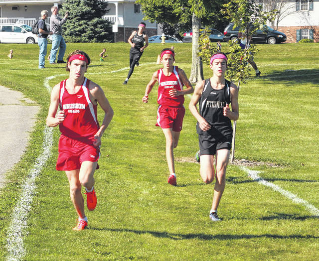 Michael Cheezan of Wauseon, front left, and Logan Rufenacht of Pettisville early in the race Saturday at the Fulton County Cross Country Invitational at Homecoming Park in Wauseon. They would finish first and second in the race.