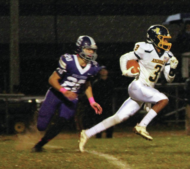 Antonio Cruz of Archbold tries to break away from the Swanton defense. He scored an early touchdown for the Streaks.