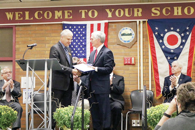 "District 5 Congressman Bob Latta (R-Bowling Green) participated in the 50th anniversary celebration of Four County Career Center in Archbold by presenting a flag flown over the U.S. Capitol building to Superintendent Tim Meister. The ceremony also included the induction of six former students into the ""Wall of Fame"" and a distinguished service award for former superintendent William Spiess. Latta commended the FCCC teachers, administrators, and students for their efforts."