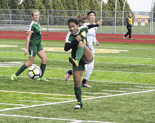 Asia Gensch of Evergreen kicks one during a Division III girls soccer sectional final Saturday. She scored the winning goal in overtime to lift the Vikings to a 3-2 win.