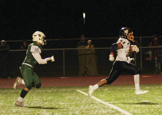 Archbold's Noah Gomez races to the end zone for a second half touchdown last Friday in a win at Evergreen. The Bluestreaks are just out of the playoffs prior to week 10, coming in at ninth in the rankings for Division V, Region 18.