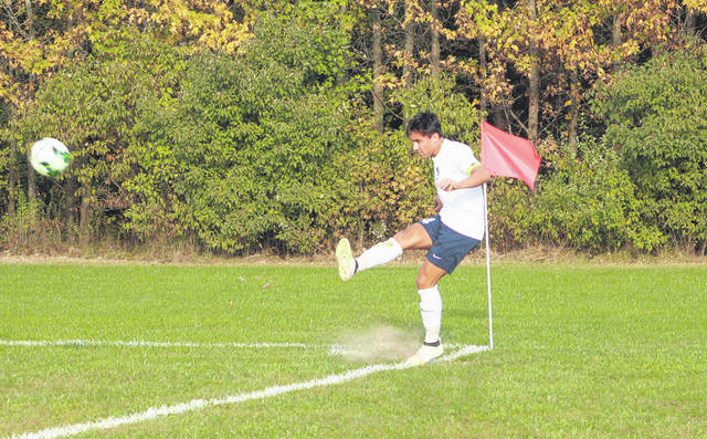 Josh Kidder of Archbold with a corner kick in a match this season. For the third straight season, Kidder was chosen the player of the year in the NWOAL.