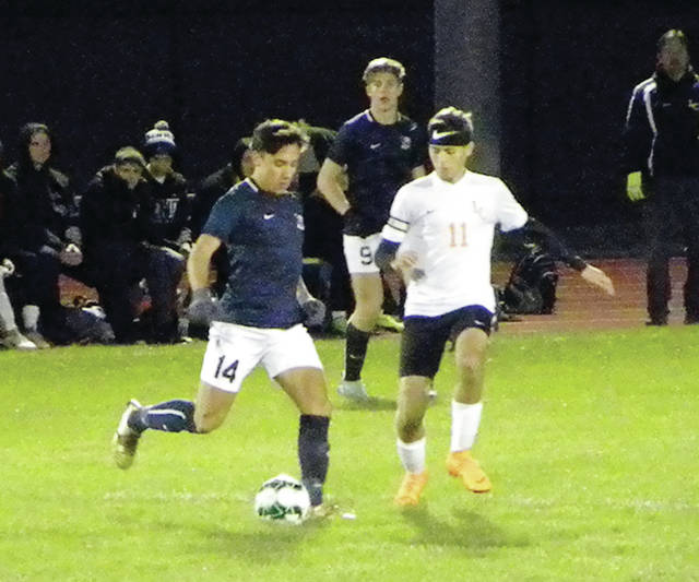 Josh Kidder of Archbold drives the ball upfield Tuesday versus Liberty Center in a Division III boys soccer district semifinal. The Bluestreaks opened up a 7-0 lead and cruised to an 11-3 win.