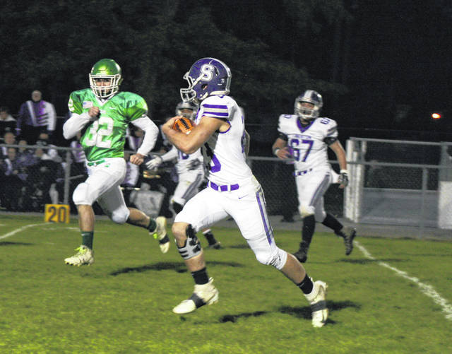 Michael Lawniczak of Swanton with the first of two touchdowns Friday in a 28-20 win at Delta. It was his first game back from injury.