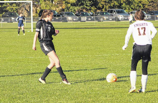 Cassandra Lee of Delta makes a pass Tuesday versus Otsego in a Division III girls soccer sectional semifinal. The Panthers disposed of the Knights with ease, 12-0.