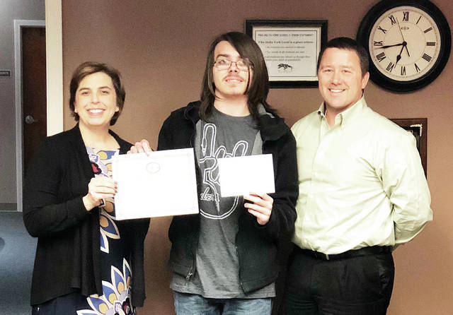Parker Tilse, center, a senior at Delta High School, has been named a Commended Student in the 2019 National Merit Scholarship Program. A letter of commendation from the school and the NMSC was presented to Tilse by Principal Kristie Reighard. He is among 34,000 Commended Students through the nation being recognized for their academic promise. Also pictured is Mike Ford, president of the Pike-Delta-York Board of Education.