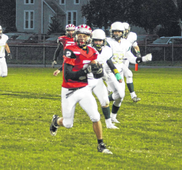 Connar Penrod of Wauseon with a reception Friday night versus Evergreen. He had both an offensive score and a defensive score as the Indians triumphed over the Vikings, 42-7.