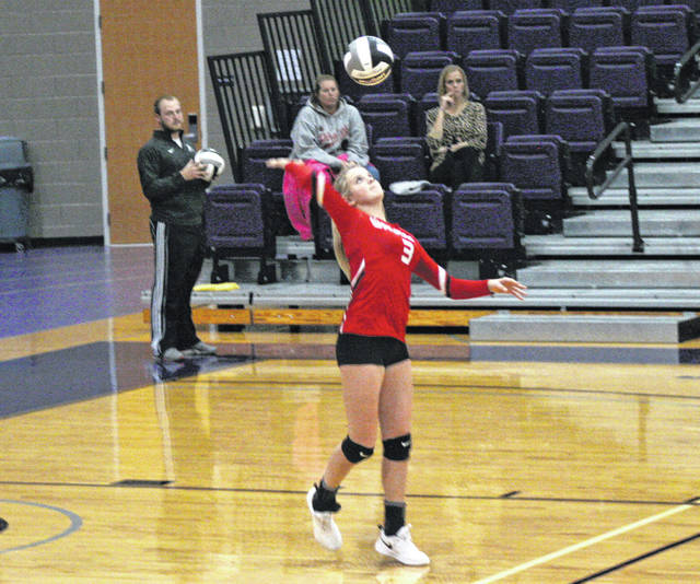 Chelsie Raabe of Wauseon serves one during a Division II volleyball district semifinal at Bluffton University Tuesday. The Indians swept Lima Shawnee 25-16, 25-22, 25-21 to advance to the district final.