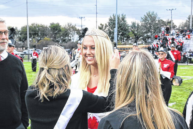 Wauseon Homecoming Queen Lexi Sauber is crowned by last year's queen Chloe Lane during a ceremony prior to Friday's home football game against Liberty Center. As for the game itself, the Tigers blanked the Indians 34-0. More inside on page 5.