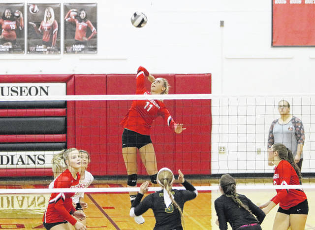Lexi Sauber of Wauseon eyes a kill Tuesday versus Evergreen in NWOAL volleyball. She notched her 1,000th kill as the Indians swept the Vikings in a pivotal league match.