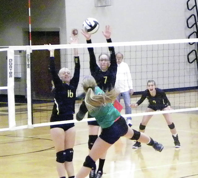 Pettisville's Anneli Shaw (16) and Danielle King (7) go for a block during Monday's home match versus Delta. The Blackbirds bested the Panthers in five sets.