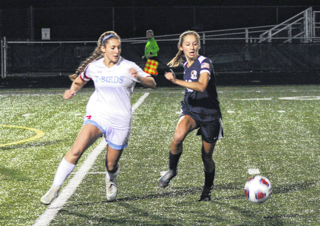 Dakota Stamm of Archbold, right, chases down a loose ball Tuesday in a Division III girls soccer regional semifinal versus Lima Central Catholic. The Bluestreaks advanced to the regional final by defeating the Thunderbirds 2-1.