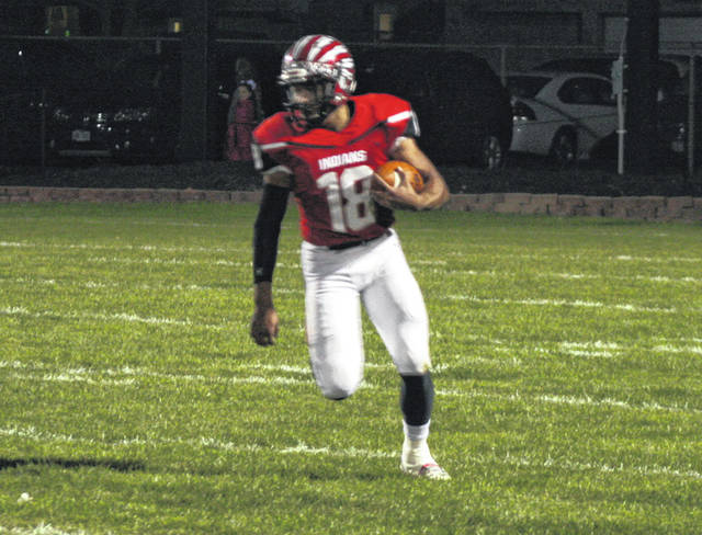 Xavier Torres of Wauseon carries the ball Friday against Delta in the season finale. The senior accounted for three total touchdowns in his final game at Harmon Field.
