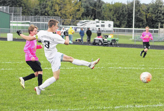 Pettisville's Detric Yoder puts in the third of his four goals Thursday in a win at Delta. The Blackbirds were victorious 6-1.