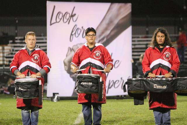 """The percussion section of the Wauseon High School Marching Indians was awarded first place in class Saturday at the Northcoast Band Contest held at Perkins High School in Sandusky. The 65-member band performed """"The World is What We Make It"""" - Look for the Helpers, Light a Candle, Be the Change under the leadership of Director Don Clark, Assistant Director Jaz Bluhm, percussionist Mark Cook, and field commander Amber Wolpert. Soloist included Mackayla Kearney, guard; Katelyn Shadboldt, trumpet; Levi Waldron, mellophone; and Lucas Schang, baritone. The Marching Indians will be in action Oct. 20, 8 p.m., at the Bulldog Bowl in Swanton."""