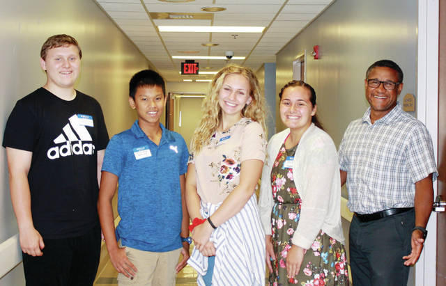Fulton County Health Center hosted two Health Care Camps for high school students over the summer. Health Care Camp is an opportunity for students to come to the hospital, learn about the health care culture, careers in health, get an extensive tour of FCHC, practice wheelchair use, and consider options for ongoing volunteering and job shadowing. The annual camps have hosted over 108 students from 19 school districts since 2015. Pictured are, from left, Nate Shafer, Liberty Center High School; Jay R Allison, Wauseon High School; Audrey Wiemken and Olivia Lehman, Napoleon High School; and Dr. Lash. Students interested in attending the Oct. 14 camp must contact Mary Gautz at 419-330-2695 or mgautz@fulhealth.org.