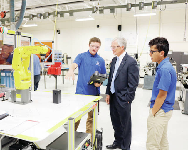 "Fifth District Congressman Bob Latta (R-Bowling Green) last Thursday toured Four County Career Center in Archbold , which just celebrated its 50th anniversary. Latta saw the center's robotics, computer programming, veterinary assistant, computer design, and health sciences programs. ""It makes you feel good to see what these students are doing to prepare themselves for their careers,"" he said."