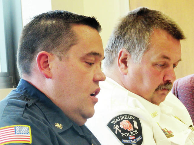 Wauseon First Assistant Chief Phil Kessler, left, informed City Council on Monday's rescue task force school shooter mock drill Oct. 30 at Wauseon High School, which will involve Police Chief Keith Torbet, right, and his department, as well as the county sheriff's office, FCHC, and Lucas County EMS.