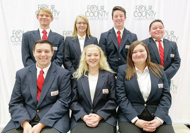 Four County Career Center in Archbold recently elected its Business Professionals of America chapter officers for the 2018-19 school year. Pictured are - front, from left - Trenton Peluso, Evergreen, president; McKenzie Reasor, Bryan, vice president; Mackenzie Davis, Montpelier, secretary - back, from left - Kaleb Ankney, Fairview, AM treasurer; Harley Kunkle, Fairview, PM treasurer; Gabe Bland, Hicksville, AM public relations; Andre Ramirez, Edgerton, PM public relations. The 75-member group sponsors activities, attends leadership workshops, and assists with Northwest Ohio Special Olympics. Advisors are Tina Short, Mary Jo Beilharz, Tim Ricketts, and Matt Geiger.