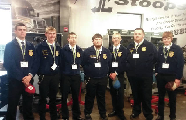 The Four County Career Center FFA chapter in Archbold recently attended the 91st National FFA Convention in Indianapolis, Ind. During the convention, FFA attendees attended several leadership and team building workshops, general sessions with motivational speakers, toured Lincoln Tech, visited the John Deere 75th anniversary display, and saw various entertainment groups. There were over 67,000 guests and FFA members present at the convention. Those attending from FCCC included – from left – Haydon Guyer of Liberty Center, Eric Culler of Fairview, Kameron Maurer of Napoleon, Skyler Bergman of Edon, Josh Brushaber of Patrick Henry, Jared Leininger of Evergreen, and Keaton Stark of Bryan Jason Elston, Ag/Diesel mechanics instructor, and Stephanie Pippin, veterinarian assistant instructor, accompanied the students.
