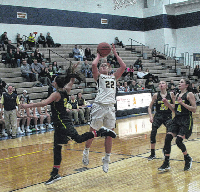 Andi Peterson of Archbold pulls up for a basket in a game against Evergreen last season. She returns as one of the Blue Streaks better players in 2018-19.