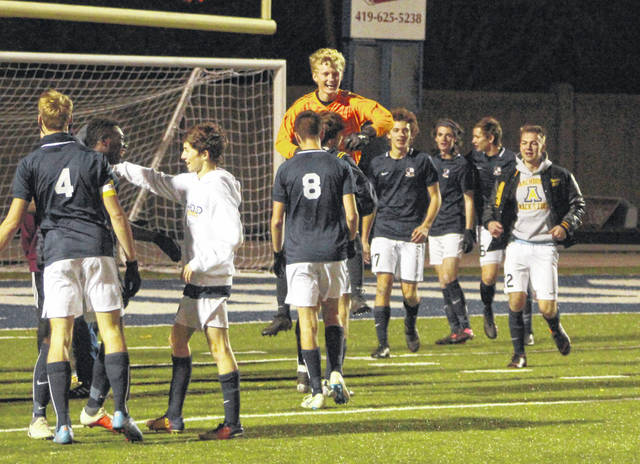 Archbold keeper Noah Cheney (in orange) and some of the Streaks show their excitement upon clinching a berth in the state title game with a 3-0 win over Kirtland in a state semifinal Tuesday.