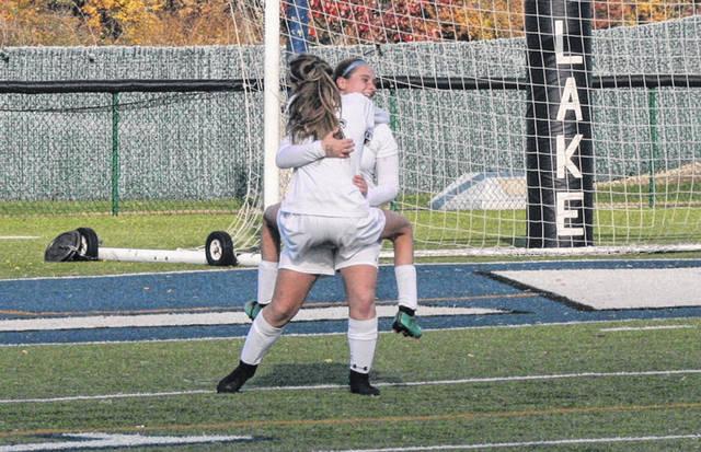 Regan Ramirez jumps into the arms of Addison Moyer to celebrate Moyer's go-ahead goal that led Archbold to a 1-0 win over Liberty-Benton in a Division III girls soccer regional final Saturday. The Bluestreaks will next take on Kirtland in the state semifinal Tuesday in Sandusky.