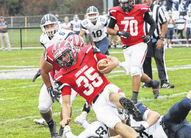 Joey Shema of Wauseon gains positive yards versus Napoleon this season. He was first team all-district in Division IV as a specialist for the Indians.