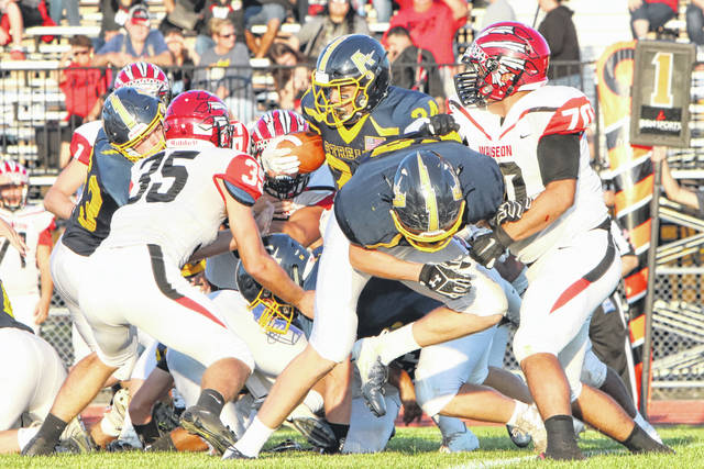 Joey Shema (35) and Trevor Rodriguez (70), both of Wauseon, surround Archbold tailback Noah Gomez in their matchup this season. Rodriguez and Shema each made special mention All-Ohio in Division IV.
