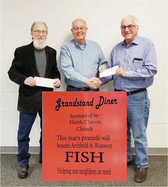 Fulton County Fair Grandstand Diner Chair Ed Miller, center, presented checks dividing the diner's proceeds of $7,366 to Jim King, left, and Paul Colon, right, for the FISH food distribution programs in Archbold and Wauseon, respectively. Miller extended a warm thank-you to fairgoers who supported this year's diner.