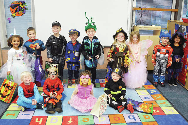 Children from the Four County Career Center Preschool in Archbold went trick-or-treating through the school on Halloween, gathering candy and goodies from the staff. Pictured are - front, from left - Zachary Norden of Napoleon, Kennedy Blue of Holgate, Camila Zetter of Toledo, Dylan Boyer of Wauseon - back from left - Laiklin Evers of Napoleon, Zane Reed of Napoleon, Jordan Inkrott of Delta, Micah Helberg of Napoleon, Blake Schroeder of Bryan, Isabella Schoonover of Defiance, Elowyn Custer of Wauseon, Brennan Vancock of Delta, and Giuliana Zetter of Toledo.