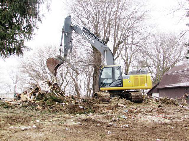 Heavy equipment on the former Worley property on County Road 6 removed debris from the demolition work. The convicted killer's house and a trailer on the property are being removed.