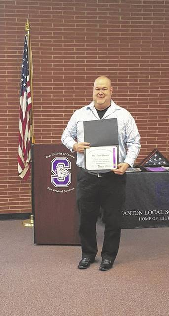Todd Omey was honored last week for his quick actions coming to the aid of a student.