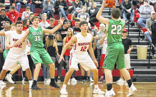 Trent Armstrong of Wauseon (12) defends Hunter Hamilton of Delta (22) Friday in a non-league contest. Armstong was key defensively for the Indians as they forced 15 Panther turnovers.