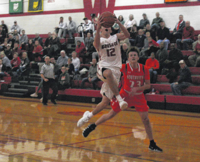 Trent Armstrong of Wauseon with a layup in transition during Tuesday's game against Sylvania Southview. He paced the Indians with 19 points.