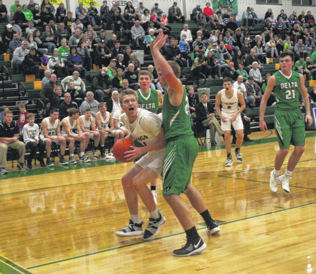 Nate Brighton of Evergreen posts up as Hunter Tresnan-Reighard of Delta defends during a non-league contest Friday at Evergreen. The Vikings took down the Panthers 58-46.