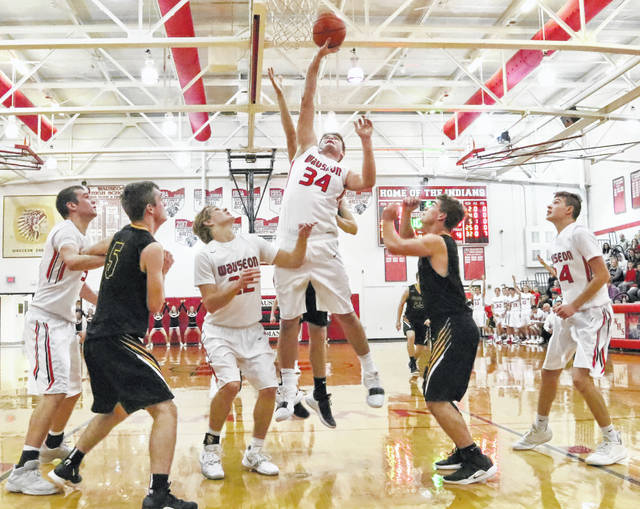 Sean Brock of Wauseon lays one in Saturday versus Fairview. The Indians outscored the visiting Apaches 33-11 after halftime for a 56-30 win.