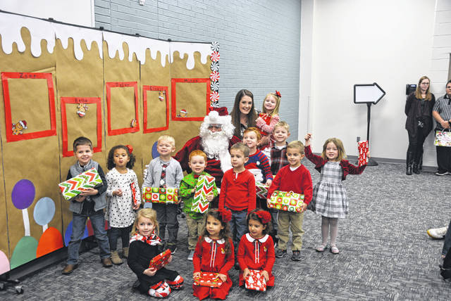 Four County Career Center Preschool/Childcare Center students recently presented their annual Christmas program for parents and grandparents. The Early Childhood Education students at the Career Center work with the children as part of their lab experience. Shown during the program with Santa Claus are front row, from left, Kennedy Blue (Holgate); Giuliana Zetter (Toledo); Camila Zetter (Toledo); (MIDDLE - LEFT TO RIGHT) Zane Reed (Napoleon); Laiklin Evers (Napoleon); Zachary Norden (Napoleon); Dylan Boyer (Wauseon); Brennan Vandock (Delta); Micah Helberg (Napoleon); Elowyn Custer (Wauseon); and back row, Santa Claus; Blake Schroeder (Bryan); Jordan Inkrott (Delta); Katelyn Flanary; Bella Schoonover (Defiance). The preschool is run under the direction of Early Childhood Education instructor Susan Myers along with Preschool Staff Person Katelyn Flanary and Education Aide Jennifer Hutchison.