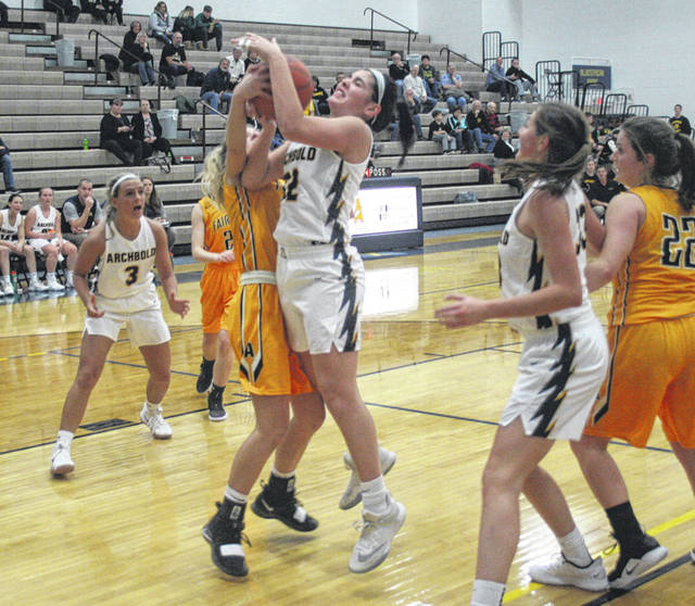 Hadley Galvan of Archbold goes up for a shot and draws a foul Tuesday during a non-league game versus Fairview. The Blue Streaks fell short to the Apaches, 52-47.