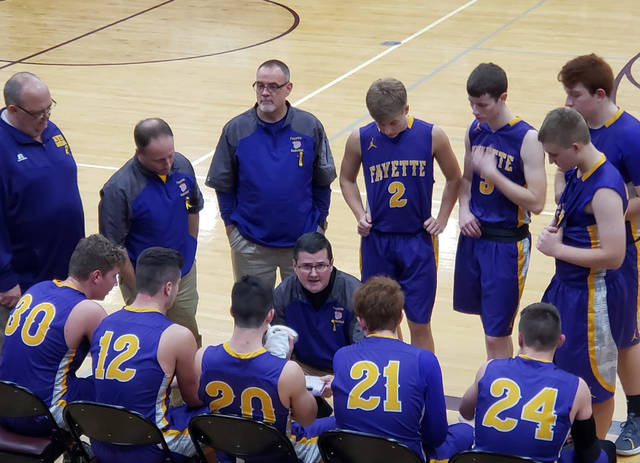 Fayette boys basketball coach Todd Mitchell addresses his team during a stoppage of play Friday against Morenci. His team's victory gave the coach his 200th career win.