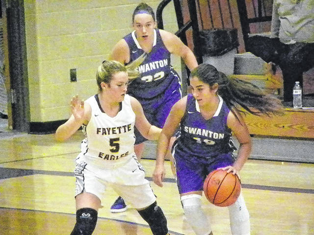 Swanton's Aricka Lutz handles the ball as Addisyn Bentley of Fayette (5) defends during Monday's game. The Bulldogs defeated the Eagles 50-32.