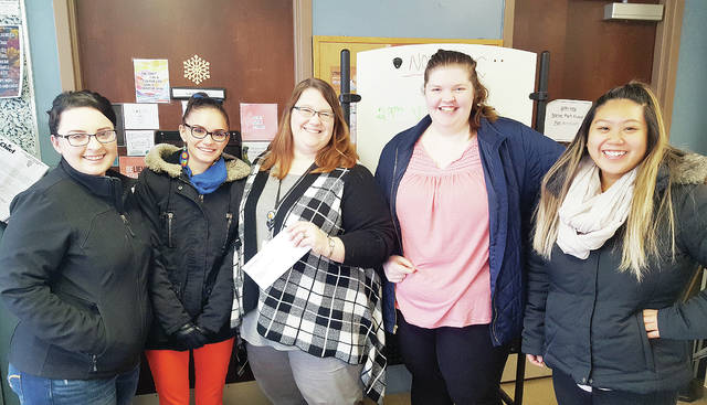 Members of the Student Body Organization at Northwest State Community College in Archbold recently delivered a check for $514 to the Path Center, a social services organization in Defiance. The donation represented proceeds raised at the college's Chili Cook-Off event in mid-October. Pictured, from left, are Taylor Newman, Izta Galindo, Susan Cheeseman of the PATH Center, Kim Eggebrecht, and Andrea Vankham.