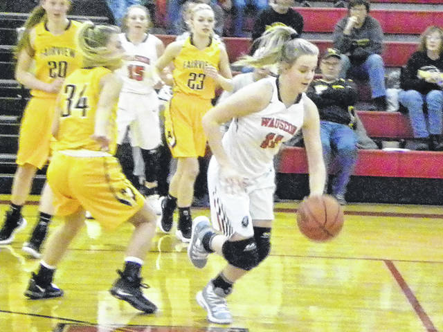 Wauseon's Chelsie Raabe dribbles the ball out of trouble Monday against Fairview. The Indians fell to the Apaches, 60-41.