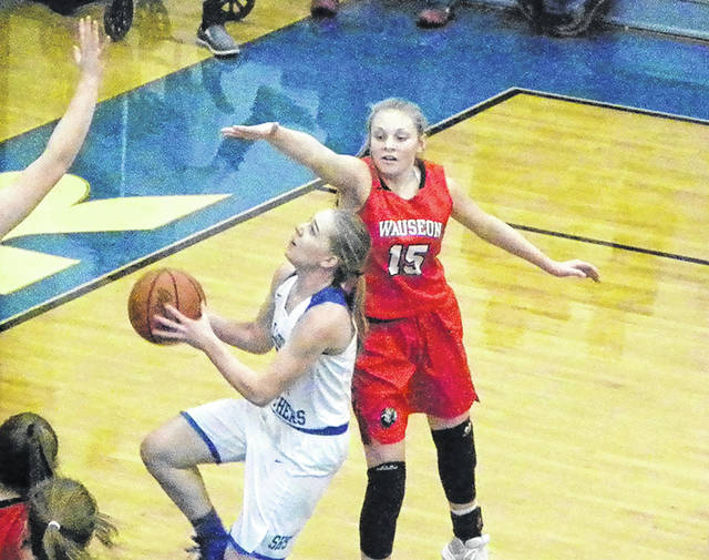Wauseon's Marisa Seiler (15) tries to block a Stryker shot during Thursday's game. The Indians fell to the Panthers 63-48.