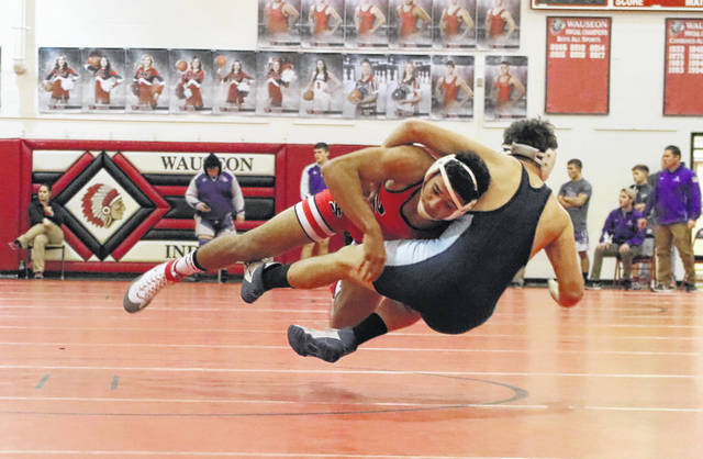 Xavier Torres of Wauseon with a takedown of Gavin Wurm of Montpelier in the 170-pound match Thursday in a NWOAL quad. The Indians defeated both Montpelier and Swanton.