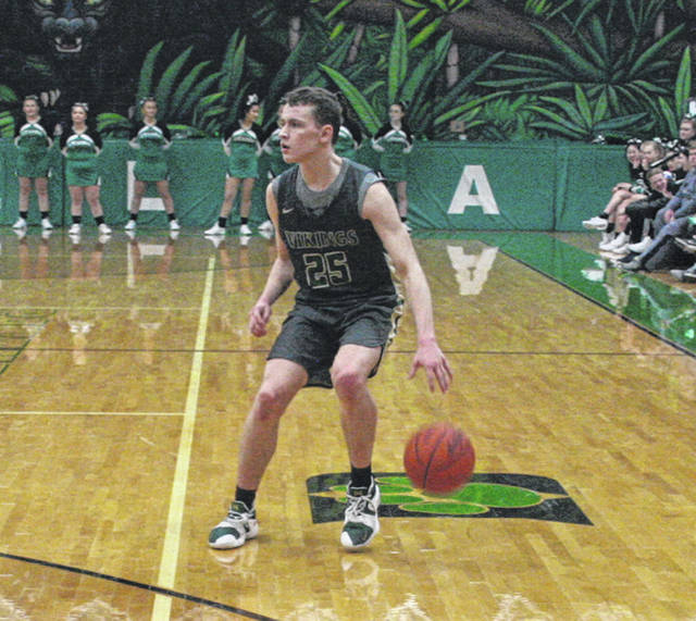Nic Borojevich of Evergreen dribbles the ball in open space Friday in a NWOAL game at Delta. The Vikings took down the Panthers 46-25 to improve to 3-0 in the league.