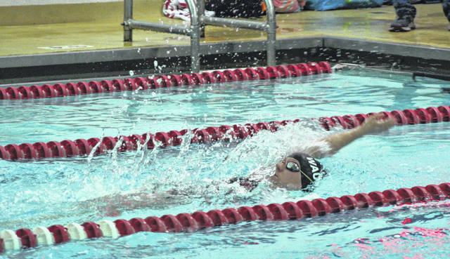 Megan Carroll of Wauseon swims in the 100-yard backstroke in a meet earlier in the season. On Tuesday during a home meet with Anthony Wayne and Bowling Green, she took second in this event.