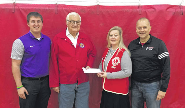 On Friday, Nov. 16, Fayette High School and Wauseon High School held an OHSAA sponsored Foundation Basketball Game involving the varsity girls and varsity boys teams from both schools. Revenue generated from the games allowed the two schools to be able to make a donation of $1,153 to the Lion's Club to go toward the Juvenile Diabetes Research Foundation. Pictured making the donation are, from left: Dylan Henricks, Fayette High School Athletic Director; Lowell Beaverson, Fayette Lion's Club President; Christy Shadbolt, Wauseon Lion's Club President; and Matt Hutchinson, Wauseon High School Athletic Director. Since 2008, Foundation Games across Ohio have generated over $500,000 for charitable organizations state-wide.