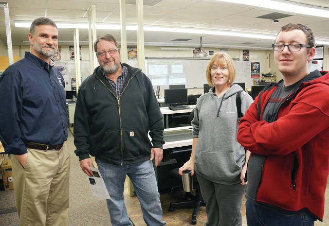 Four County Career Center in Archbold hosted a Career Night Open House, with the center's labs and classrooms open to the public. Instructors and counselors were available to answer questions and acquaint visitors with career and technical programs and college credit options. Pictured - from left - are Computer Networking and Cybersecurity instructor Tim Ricketts with Tim Sheffer, Teresa Sheffer, and Travis Sheffer all from Wauseon. The Career Center offers 30 career and technical programs to high school juniors and seniors from 22 high schools in Fulton, Defiance, Henry, and Williams counties.